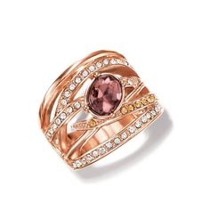 """Open design 3/4"""" wide band ring with faceted brown center faux stone with clear and brown rhinestones set in rose goldtone. Imported."""