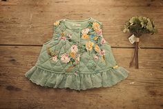 - Vintage Inspired vest - Available in mint and pink - Beautiful floral patterns - Adorable buttons for closure - Lovely decorative lace on bottom - Easy to combine - Made of soft cotton - Imported - Machine wash   MONEY BACK WARRANTY In case you are not 100% satisfied with your produc...