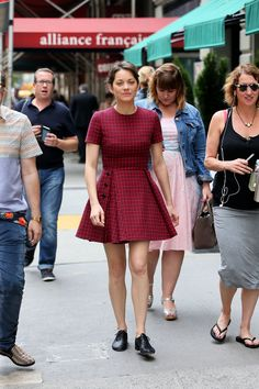 Marion Cotillard in a flared mini dress and oxfords.