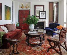 Beautiful Bohemian sitting room: Velvet sofa and vintage rug by Martyn Lawrence- Bullard