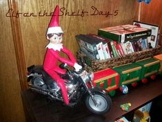 Elf on the shelf, going for a ride.