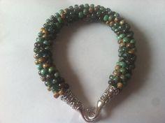 Evergreen Kumihimo Bracelet by CreationsMadeByLola on Etsy https://www.etsy.com/listing/175890537/evergreen-kumihimo-bracelet