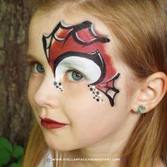 Spider-Man inspired face painting.