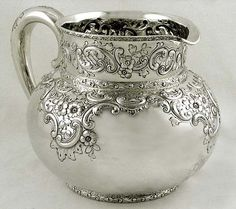 Ornate Dominick & Haff sterling silver water pitcher, c1892