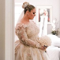 Here is a long sleeve wedding gown that has beautiful flower embellishments.  This off the shoudler style can be recreated with any changes.  We are in the USA and make custom #weddingdresses.  We also make #replicas of couture designer gowns for brides who can not afford the original.  Email us directly for pricing.  DariusCordell.com