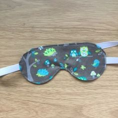 Fabric Eye Mask – a Box of Buttons Learn how you can make your own! Make Your Own, Make It Yourself, How To Make, Fabric Shears, Owl Print, Eye Shapes, Printing On Fabric, Buttons, Sewing