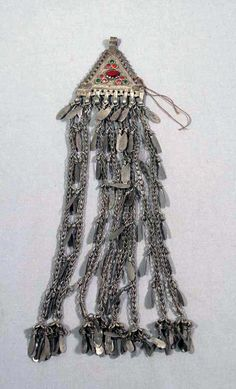 Afghanistan   Pendant; silver plating, metal and glass    Collection Helinä Rautavaaran Museum; acquisition date ca. 1954