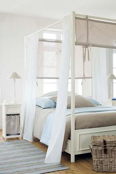 Narrow side tables and lamps. neutral | white | pale blue..very calming