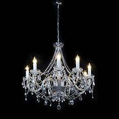 12682: A large cut glass chandelier in the late Georgian Englsh manner with eight scrolled arms supporting etched drip pans hung with long bead chains and glass pendants with a glass ball at the base. English