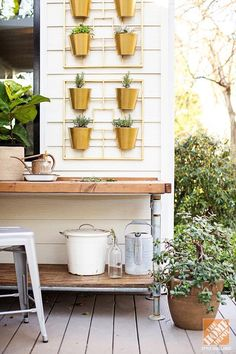 Trendspotting: Vertical gardens! Customize the hanging pots with spray paint for a unique look.