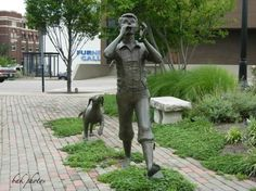 """Front of sculpture of Robert McCloskey's Lentil in Hamilton, Ohio (McCloskey's native town) on the corner of High at Front St. Nancy Schon, creator of the """"Make Way for Ducklings"""" sculpture in Boston, was commissioned to create the life-size replica of """"Lentil"""" and his dog. Five In A Row, The Row, Blueberries For Sal, Robert Mccloskey, Make Way For Ducklings, In Boston, Children's Books, Arrows, Hamilton"""