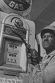 Amoco gas attendant and vintage Wayne gas pump.
