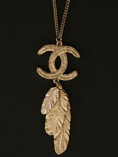 """Vintage Chanel Double """"C"""" Pendant featuring Three Multi Size Feather Drops. Available at London Jewelers!"""