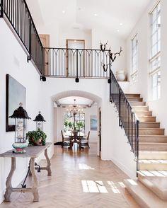 AFTER | Another wrought iron stairwell  herringbone wood floor to swoon over! . . . Builder: @pattersoncustomhomes Lens: @jkoegel