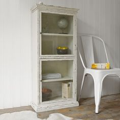 These rustic wooden cabinets provide versatile decorative storage and are perfect for all rooms in the house. Ideal as a wall hanging unit or placed on the floor for low level storage. Available in Pink, Cream or Sea Green each cabinet has a carefully considered distressed paint finish, 3 interior shelves and two glass doors.