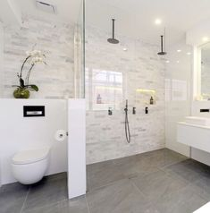 I like the clear doors and how the flooring is the same throughout the bathroom. Walk in\/ no step up.