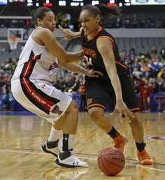 Oklahoma State's Kendra Suttles (31) goes past Texas Tech's Kelsi Baker (41) during the Big 12 tournament women's college basketball game between Oklahoma State University and Texas Tech University at American Airlines Arena in Dallas, Saturday, March 9, 2012. Oklahoma State won 59-54.  Photo by Bryan Terry, The Oklahoman