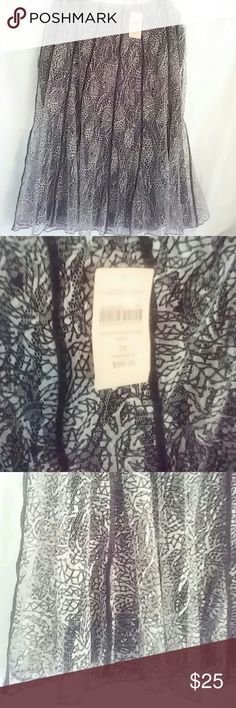 Elastic waist Coldwater Creek flowing midi skirt NWT gorgeous lace overlay and beneath is a black polyester liner. Dance the night away in this free flowing skirt. Coldwater Creek Skirts Midi