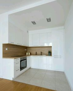 The design of the dream kitchen using white collaboration with wooden floors is . - The design of the dream kitchen using white collaboration with wooden floors is very suitable to loo - Simple Kitchen Design, Kitchen Room Design, Kitchen Cabinet Design, Home Decor Kitchen, Interior Design Kitchen, Home Kitchens, Decorating Kitchen, Kitchen Ideas, Apartment Kitchen