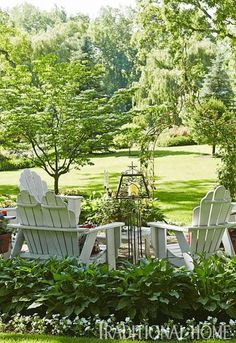 Love semi circle of chairs and hostas framing them