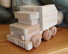 A set of 4 Mighty Wood Trucks