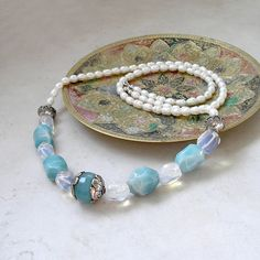 Opera Length Gemstone Necklace featuring Amazonite, Opalite, & Tibetan Silver and Blue Chalcedony Focal Bead by Foret, $225.00