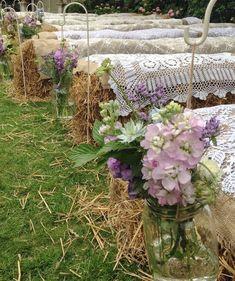 Country wedding with hay bale seating & jam jar flowers on shepherds crooks. I like this idea with different flowers! Farm Wedding, Wedding Table, Diy Wedding, Wedding Ideas, Wedding Country, Trendy Wedding, Cowgirl Wedding, Wedding Shot, Wedding Themes