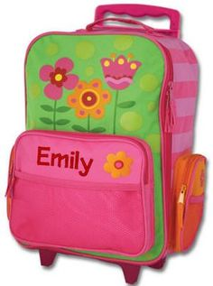 Rolling Luggage Flower. Rolling flower luggage has a hot pink striped shell and lime green front with circles, a  hot pink front pocket with a mesh, and an orange and red flower. The front is detailed in bright colorful flowers. Each of these pieces coordinate with our backpacks and lunch totes. Each piece of kid's rolling luggage has a carry handle, a zippered front opening, a front mesh pocket, and two side zippered pockets. Embroidery of her name or initials will be …