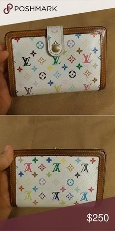 Louis Vuitton LV Monogram Multi White Kiss Lock Louis Vuitton LV Monogram Multi White Kiss Lock Wallet Made in France Date Code TH1025 Pre-owned with normal wear Canvas is in excellent shape  Wallet is limited edition Murakami Collection Discontinued and no more made There some fading on the monogram mostly toward the bottom All corners are in Good condition Inside as well  No peeling or stickiness no rips or cracks  Leather is honey patina Normal Pre owned sithat of wear throughout and…