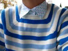 a blue sweater.
