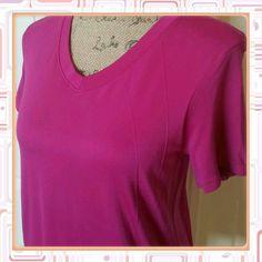 Mmm magenta colored sport shirt Hot magenta colored sport shirt. Nylon spandex blend. Beautiful cond Champion Tops