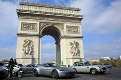 Paris' most iconic boulevard was the scene for a spectacular exhibition on Sunday when a series of cars that captured the public imagination through their appearances in James Bond drove past stunned bystanders.
