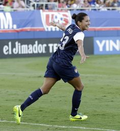 Christen Press celebrates one of her two goals against Russia on Feb. 8, 2007. (Alan Diaz/AP)