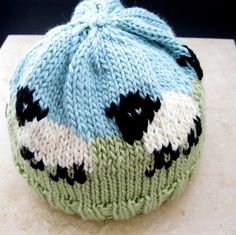 This fun sheep hat is hand knitted in a black, green, light blue and cream colored merino mix yarn, with a nice soft feel to it.It would be nice for your toddler, your grand child or a friends baby. For a photo session or as a gift.The hat fits comfortably a 16 inch to a 19 inch head.The colors are black, cream, green and light blue.care: machine wash warm, gentle cyclemachine dry low, delicate cycle