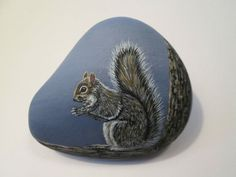Squirrel hand painted on a rock by Ann Kelly #Realism