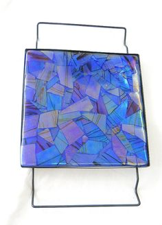 4 Layers of glass fused to one solid smooth surface, this blue trivet will be a hit on your dining table this winter!  $49.99