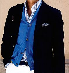Nice layers, way to incorporate color into an otherwise black and white outfit, classy but still without a tie.