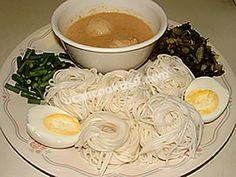 Rice Noodle Nests with Fish Sauce | thin rice noodles 2 cans (170 g.) flaked light tuna  1 package (300 g.) pickled mustard 4 Tbsp red cuury paste 1 can coconut milk 1/3 cup krachai 2 large eggs 100 g. long green beans 250 g. fish balls 2 Tbsp thin soy sauce (or fish sauce) 2 Tbsp sugar