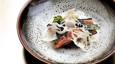 Bennelong at the Opera House: Chef Peter Gilmore's Roasted Hombre duck, hispi cabbage, black miso and seaweed. Photograph by Edwina Pickles. 19th June 2015.