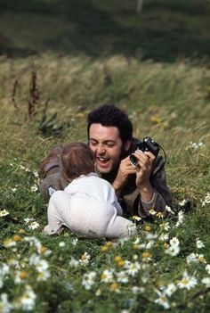 A beautiful photo (~1970) of Beatles singer Paul McCartney spending quality time taking photos of his beloved baby girl, Stella.  I just love how much he looks like he adores her.  Just think if every little girl had a father who truly adored them -- it would make all the difference in the world in their lives.
