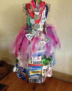 """""""Race bibs serve as cool keepsakes and motivational reminders of past triumphs.""""-RW I couldn't agree more!-Juli"""