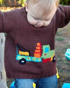 Free Knitting Pattern for Truck Sweater for Babies and Children - Long-sleeved pullover with detailed truck motif. Sizes Chest 24″-30″, 2-8. Designed by Tonia Barry. Pictured project by StephB