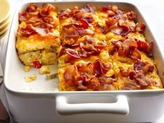 A fluffy layer of eggs topped with crispy, thick-cut bacon.