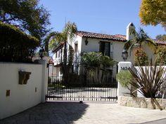 A glimpse of Spanish Colonial behind gates...