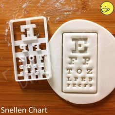 SIZE: Snellen Chart: Approximately by inches by inches) Eyeglasses: Approximately by inches by inches) thickness of dough will be perfect inch) ESSENTIAL TIPS: ♥ For easy release of dough, remember to coat the cutter with icing sugar/ flour Biscuit Cookies, Cookie Dough, Cookie Cutters, Craft Clay, Gadget, Eye Chart, Healthy Eyes, Eye Doctor, Cookie Designs