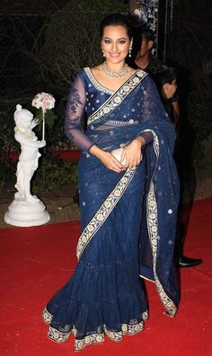 Dazzle the party with the Sonakshi Sinha Lehenga Saree. Exclusive net saree worked with lace and resham turns heads wherever you go. The gorgeous embroidery and the vibrant blue color will make you look like a true diva. Bollywood Saree, Lehenga Saree, Saree Dress, Bollywood Fashion, Bollywood Actress, Net Saree, Sabyasachi, Indian Bollywood, Saree Blouse