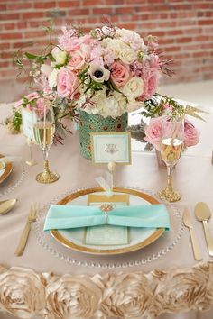 Mint and gold floral table setting - love the rosettes that line the table