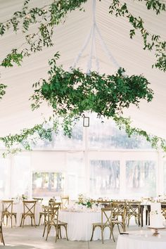"""From the editorial """"Find Out Why Toffee Is Officially Our New Favorite Wedding Hue."""" Just wait until you see more photos of this tented reception! The bride and groom went with neutral color palette to let their toffee roses shine and it was absolutely magical!  LBB Photographer: @clarypfeiffer  #weddingreception #tentwedding #tentedwedding #outdoorwedding #classicwedding #summerwedding"""