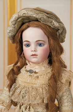 French Bisque Blue-Eyed Bebe from the Classic Era by Leon Casimir Bru, Size 8 7000/10,000