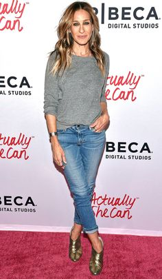 Sarah Jessica Parker in a gray sweater, jeans and gold heels